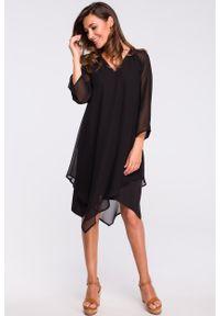 e-margeritka - Sukienka szyfonowa elegancka czarna - l. Okazja: na wesele, na ślub cywilny, na imprezę, na co dzień. Kolor: czarny. Materiał: szyfon. Typ sukienki: proste, asymetryczne, trapezowe. Styl: elegancki. Długość: midi
