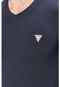 Niebieska koszulka z długim rękawem Guess Jeans