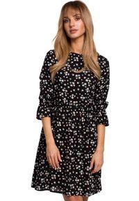 MOE - Rozkloszowana krótka sukienka oversize na lato. Materiał: tkanina. Wzór: nadruk, kwiaty. Sezon: lato. Typ sukienki: oversize. Długość: mini