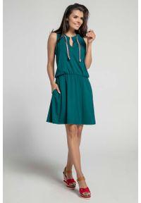 Zielona sukienka Nommo sportowa, sportowa