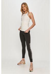 Calvin Klein Jeans - Legginsy. Kolor: czarny. Materiał: dzianina. Wzór: nadruk