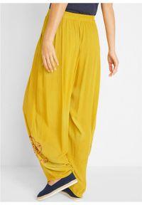 Żółte spodnie bonprix z nadrukiem