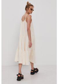Superdry - Sukienka. Kolor: beżowy. Materiał: dzianina. Długość rękawa: na ramiączkach. Wzór: gładki. Typ sukienki: rozkloszowane