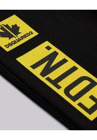 DSQUARED2 KIDS - Czarne spodnie dresowe z kontrastowym nadrukiem 4-16 lat. Kolor: czarny. Materiał: dresówka. Wzór: nadruk. Sezon: lato