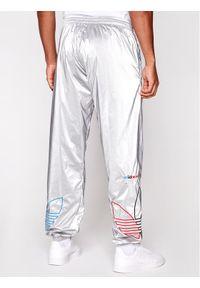 Srebrne spodnie dresowe Adidas