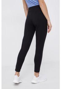 4f - 4F - Spodnie. Stan: podwyższony. Kolor: czarny. Materiał: dzianina. Wzór: aplikacja
