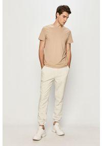 Jack & Jones - Spodnie. Kolor: biały. Materiał: dzianina, poliester, bawełna. Wzór: gładki #4