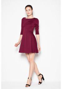 e-margeritka - Sukienka rozkloszowana zapinana na zamek - s. Okazja: do pracy, na imprezę, na spotkanie biznesowe. Materiał: wiskoza, materiał, elastan, tkanina, skóra, poliester. Wzór: jednolity. Typ sukienki: rozkloszowane. Styl: biznesowy, elegancki. Długość: midi