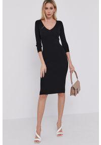 Guess - Sukienka. Kolor: czarny. Materiał: dzianina. Wzór: gładki