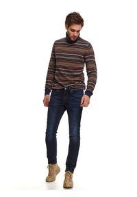 TOP SECRET - Spodnie denim o kroju slim. Okazja: na co dzień, do pracy. Kolor: niebieski. Materiał: denim. Wzór: aplikacja. Sezon: zima. Styl: casual