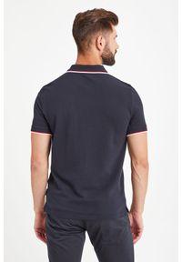 Koszulka polo Armani Exchange w kolorowe wzory, sportowa