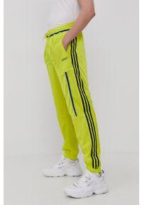adidas Originals - Spodnie dwustronne. Okazja: na co dzień. Kolor: żółty. Materiał: poliester. Styl: casual