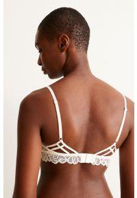 Kremowy biustonosz Undiz z odpinanymi ramiączkami, w koronkowe wzory