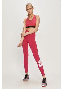 Nike Sportswear - Legginsy. Stan: podwyższony. Kolor: różowy. Wzór: nadruk