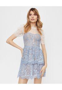 SELF PORTRAIT - Niebieska sukienka mini. Typ kołnierza: dekolt gorset. Kolor: niebieski. Materiał: tkanina, koronka. Wzór: kropki, kwiaty, koronka, ażurowy. Typ sukienki: gorsetowe, rozkloszowane, dopasowane. Styl: elegancki. Długość: mini