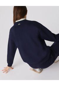Lacoste - LACOSTE - Bawełniana bluza z logo. Kolor: niebieski. Materiał: bawełna. Wzór: haft