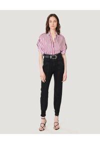 IRO - Czarne jeansy z przeszyciami Boucry. Stan: podwyższony. Kolor: czarny. Długość: długie