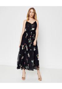 JENESEQUA - Jedwabna sukienka MARSEILLE BLACK. Okazja: na co dzień. Kolor: czarny. Materiał: jedwab. Długość rękawa: na ramiączkach. Wzór: kwiaty, nadruk. Typ sukienki: proste. Styl: casual. Długość: maxi