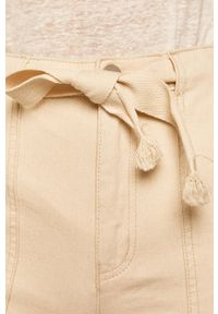 Kremowe jeansy medicine