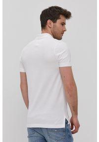 Tommy Jeans - Polo. Typ kołnierza: polo. Kolor: biały. Materiał: dzianina. Wzór: gładki