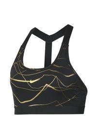 Biustonosz sportowy damski Nike Swoosh Icon Clash CT3493. Materiał: skóra, nylon, poliester, materiał. Rodzaj stanika: wyciągane miseczki. Technologia: Dri-Fit (Nike). Sport: wspinaczka, fitness