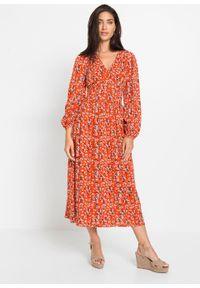 Sukienka bonprix matowy pomarańczowy w kwiaty. Typ kołnierza: dekolt w serek. Kolor: pomarańczowy. Wzór: kwiaty