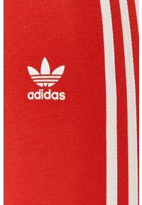 Czerwone legginsy adidas Originals