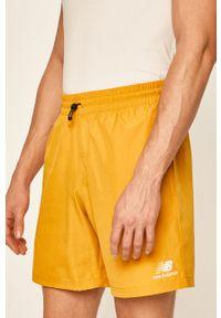 New Balance - Szorty. Okazja: na co dzień. Kolor: żółty. Styl: casual
