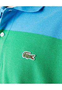 Lacoste - LACOSTE - Bawełniana koszulka polo Polaroid Regular Fit. Typ kołnierza: polo. Kolor: czerwony. Materiał: bawełna. Wzór: haft, paski. Styl: klasyczny