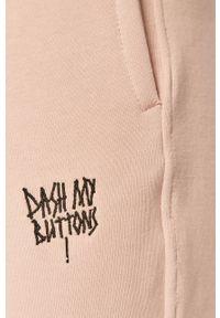 Różowe spodnie dresowe gładkie
