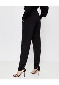 ISABEL MARANT - Czarne spodnie z wysokim stanem. Stan: podwyższony. Kolor: czarny. Materiał: wełna. Sezon: lato