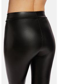 Czarne legginsy Wolford z podwyższonym stanem, gładkie