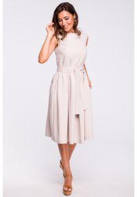 e-margeritka - Sukienka rozkloszowana bez rękawów beżowa - m. Kolor: beżowy. Materiał: len, materiał, poliester. Długość rękawa: bez rękawów. Typ sukienki: plisowane, rozkloszowane. Styl: elegancki