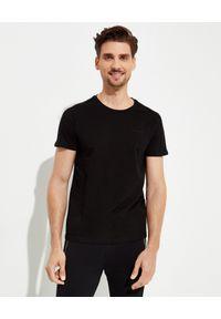 Balmain - BALMAIN - Czarny t-shirt z logo. Kolor: czarny. Materiał: bawełna