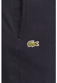 Lacoste - Spodnie XH9507. Kolor: niebieski. Materiał: materiał, bawełna, dzianina, poliester, elastan. Wzór: gładki #5
