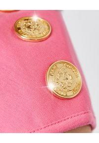 Balmain - BALMAIN - Różowy t-shirt z logo. Okazja: na imprezę. Kolor: wielokolorowy, fioletowy, różowy. Materiał: bawełna