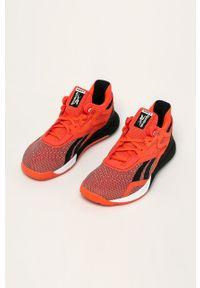 Pomarańczowe sneakersy Reebok na sznurówki, z okrągłym noskiem