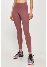 Nike - Legginsy. Stan: podwyższony. Kolor: fioletowy. Materiał: włókno, skóra, tkanina. Technologia: Dri-Fit (Nike)
