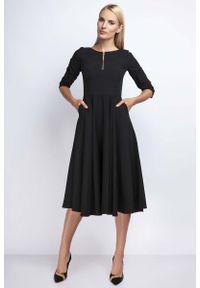 Nommo - Czarna Rozkloszowana Sukienka za Kolano z Kontrastowym Zamkiem. Kolor: czarny. Materiał: wiskoza, poliester