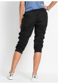 Czarne spodnie bonprix w prążki