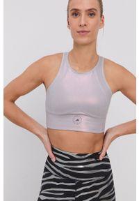 Adidas by Stella McCartney - adidas by Stella McCartney - Biustonosz sportowy. Kolor: różowy. Materiał: materiał. Rodzaj stanika: odpinane ramiączka