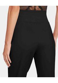 Wolford - WOLFORD - Czarne spodnie Athene. Kolor: czarny. Materiał: wiskoza, materiał, elastan