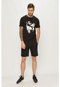 Czarny t-shirt Puma casualowy, na co dzień, z nadrukiem