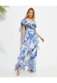 Camilla - CAMILLA - Jedwabna sukienka maxi High Tea. Kolor: biały. Materiał: jedwab. Wzór: kwiaty, aplikacja. Typ sukienki: kopertowe, asymetryczne, rozkloszowane. Długość: maxi