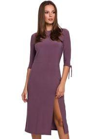 Makover - Elegancka sukienka prosty fason z rozcięciem. Okazja: na co dzień. Materiał: dzianina. Wzór: gładki. Typ sukienki: proste. Styl: casual, elegancki. Długość: midi