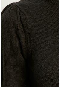 Jacqueline de Yong - Sukienka. Kolor: czarny. Materiał: dzianina. Długość rękawa: krótki rękaw. Wzór: gładki