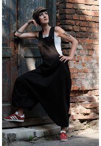 Hultaj Polski - Spodnie damskie Hultaje czarne. Kolor: czarny. Materiał: tkanina, elastan, bawełna. Długość: długie. Styl: młodzieżowy