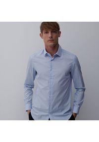 Reserved - Koszula slim fit z drobnym wzorem - Niebieski. Kolor: niebieski