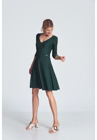e-margeritka - Sukienka koktajlowa wizytowa zielona - s. Okazja: do pracy. Kolor: zielony. Materiał: poliester, wiskoza, materiał, elastan. Typ sukienki: rozkloszowane. Styl: wizytowy