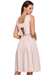 Makover - Elegancka rozkloszowana sukienka eksponująca plecy. Okazja: do pracy. Styl: elegancki. Długość: midi